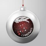 与冷杉分支的圣诞节球和在里面降雪下的一点圣诞节球 库存图片