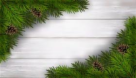 与冷杉的圣诞节背景在白色木桌上分支 免版税库存图片