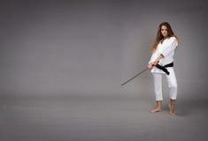 与准备好的剑的Ninja击中 库存照片