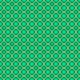 与几何形状的无缝的纹理以在绿色背景的花的形式 库存照片