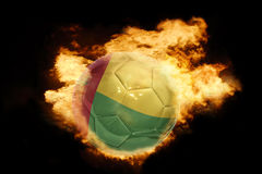 与几内亚比绍的旗子的橄榄球球火的 库存照片