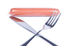 与刀子和叉子的香肠 免版税库存图片