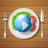 与刀子和地球的叉子在板材 库存图片