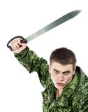 与刀子的军人攻击 库存图片
