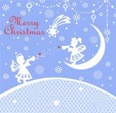 与切开小的天使、垂悬的装饰和圣诞节星的纸的淡色蓝色天真幼稚Xmas贺卡 库存照片