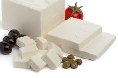 与切片和立方体的希腊白软干酪 免版税库存图片