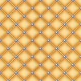 与别针的无缝的金黄缝制的背景 库存照片