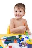与刷子的小男孩图画 免版税库存图片