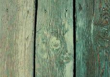 与削皮油漆的老木板条 绿色葡萄酒背景 免版税图库摄影