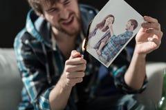 与前女友的灼烧的照片 免版税库存图片