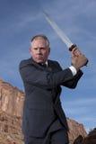 与剑的生意人 库存照片