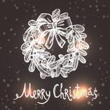 与剪影花圈的圣诞卡 免版税库存照片