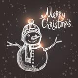 与剪影雪人的圣诞卡 免版税图库摄影