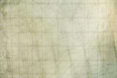 与加强钢绳滤网的抽象背景双玻璃  库存照片