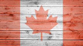 与加拿大的旗子的颜色的木纹理背景 免版税库存照片