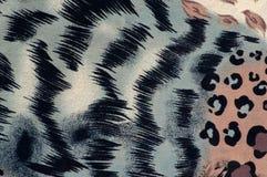 与动物印刷品背景关闭的五颜六色的织品 免版税图库摄影