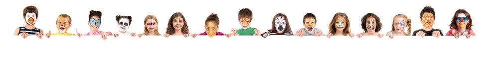 与动物面孔油漆的孩子 库存图片