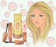 与化妆用品的美丽的白肤金发的女孩面孔 免版税图库摄影