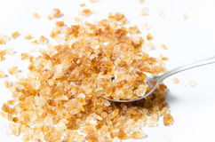 与匙子的岩石糖 免版税库存照片