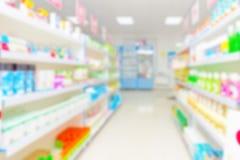与医学和其他物品的抽象背景迷离架子在药房 免版税库存图片