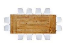 与十二把椅子的大木表 免版税库存照片