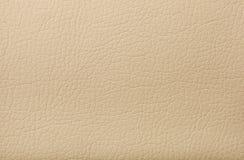 与印刷品的软的米黄皮革纹理作为背景 免版税库存照片