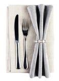 与叉子的典雅的饭桌在一灰色tabl的设置和刀子 库存照片