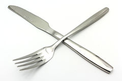 与叉子的利器在白色背景隔绝的集合和匙子 免版税图库摄影