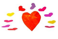与反复的小调的一橙色纸心脏形状 图库摄影
