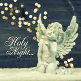 与发光的光的小的守护天使 圣诞节装饰装饰新家庭想法 库存图片