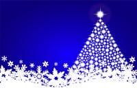 与发光的圣诞树的蓝色圣诞节背景 库存照片