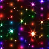 与发光的圣诞节链子的彩虹无缝的背景 免版税库存图片