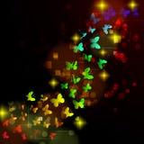 与发光的夜的蝴蝶的抽象设计 免版税图库摄影