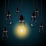 与发光的电灯泡在深蓝背景eps 10 免版税图库摄影