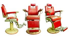 与古板的镀铬物椅子的理发店 库存图片