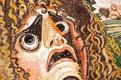 与可怕的表面的古老罗马马赛克 库存照片