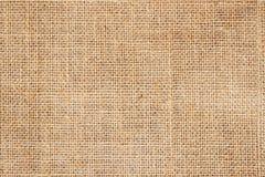 与可看见的纹理拷贝空间的麻袋布或粗麻布背景文本和其他网印刷品的设计元素 免版税库存照片