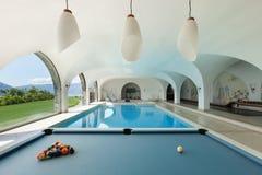 与台球的室内游泳池 库存图片