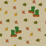 与叶子和胶靴的背景 免版税库存照片