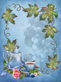 与叶子和茶杯的蓝色背景 免版税库存照片