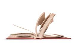 与叶子的一本开放书在行动 免版税库存图片