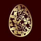 与叶子的透雕细工金黄复活节彩蛋 激光切口或阻止 图库摄影
