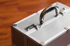 与号码锁的金属盒 秘密 免版税库存图片