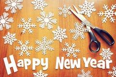 与各种各样的雪花的新年背景 免版税库存图片