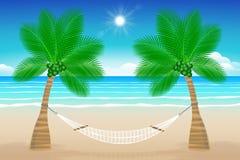 与吊床的海滩 免版税库存图片