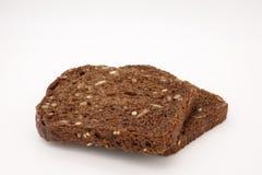 与向日葵种子和芝麻的黑面包 免版税库存图片