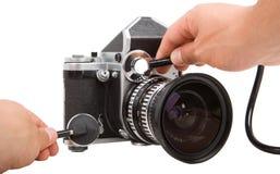 与听诊器的老照相机修理 免版税库存图片