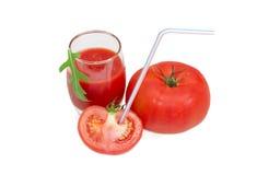与吸管和西红柿汁的蕃茄 免版税图库摄影