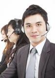 与呼叫中心座席的微笑的生意人 图库摄影