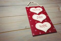 与和平、喜悦和希望按摩的圣诞节标签  库存图片